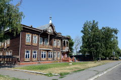 The old wooden building, the former home of the merchants Shadrin on Krasnoarmeysky Avenue in Barnaul. BARNAUL, RUSSIA - JULY 2, 2015:The old wooden building Royalty Free Stock Photography