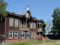 The old wooden building, the former home of the merchants Shadrin on Krasnoarmeysky Avenue in Barnaul. BARNAUL, RUSSIA - JULY 2, 2015:The old wooden building Royalty Free Stock Image