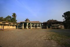 Old wooden building in Myanmar in the courtyard. royalty free stock photography