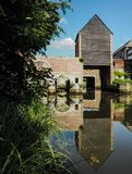 The old wooden building Spuihuis, part of the 15th century water. Mill complex in Mechelen, Belgium, crossing the river Dijle Royalty Free Stock Photo