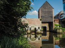 The old wooden building Spuihuis, part of the 15th century water. Mill complex in Mechelen, Belgium, crossing the river Dijle Stock Photos