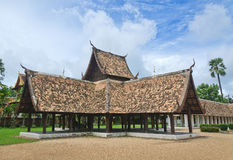 Old wooden building with a thatched roof tiles Royalty Free Stock Photos