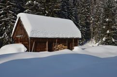Old wooden building in winter. In the sunshine Royalty Free Stock Image