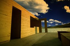 Old wooden builing under dramatic sky.  Stock Photography