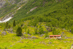 Old wooden cabin in forest Norway Stock Photo