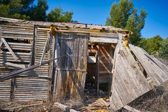 Old wooden cabin house destroyed by hurricane. And abandoned Royalty Free Stock Photo