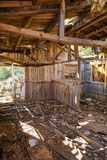 Old wooden cabin house destroyed by hurricane. And abandoned Stock Images