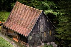Old wooden cabin mill in Black forest royalty free stock photos