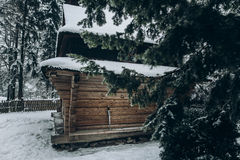 Old wooden cabin in Norway located in winter woods, rustic wood Stock Image