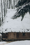 Old wooden cabin in Norway located in winter woods, rustic wood Stock Photo