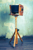 Old wooden camera on tripod. Old vintage wooden camera on tripod Royalty Free Stock Photos