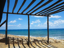 Old wooden canopy on the sea coast and blue sky Royalty Free Stock Photo