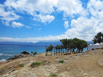 Old wooden canopy on the sea coast and blue sky Stock Photo
