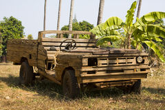 Old wooden car in the jungle Royalty Free Stock Photo