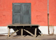 Old Wooden Cargo Ramp and Red Wall Stock Images