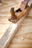 Old wooden carpenter tool plane Royalty Free Stock Images