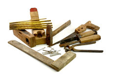 Old wooden carpenter tools. On white background Royalty Free Stock Photos