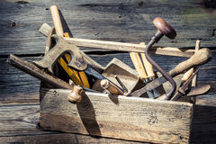 Old wooden carpenters box with tools royalty free stock images