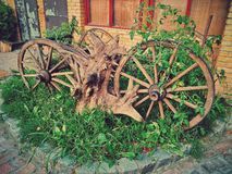 Old wooden carriage. On a green grass Royalty Free Stock Photography