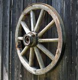 Old wooden carriage wheel. Stock Image