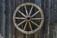 Old wooden carriage wheel. Royalty Free Stock Images