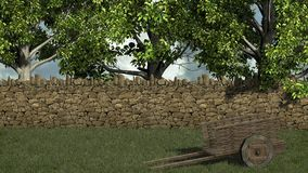 Old wooden cart in front stone wall and trees Royalty Free Stock Image