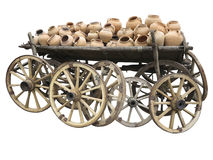 Old wooden cart full of clay pottery and wheels isolated over wh Stock Photo