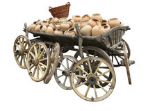 Old wooden cart full of clay pottery, wheels and wicker basket i Stock Photos