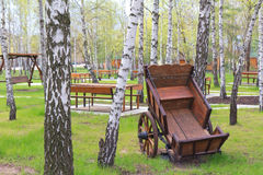 Old wooden cart in garden Royalty Free Stock Images