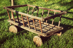 Old wooden cart in the garden Royalty Free Stock Photography