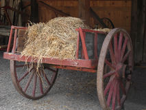 Old wooden cart with hay. stock images