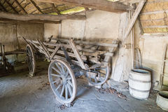 Old wooden cart inside barn Stock Images