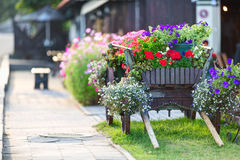 Old wooden cart rebuilt as a flower bed Stock Photo