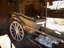 Old wooden cart standing in one old barn Stock Photos