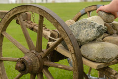 Old wooden cart with stones - close-up Royalty Free Stock Photography