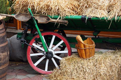 Old wooden cart with straw Stock Images