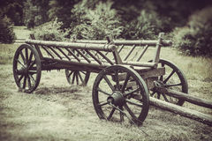 Old wooden cart, vintage stylized photo Royalty Free Stock Photo