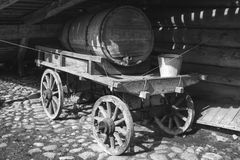 Old wooden cart with water tank. Old rural wooden cart with water tank, black and white photo Royalty Free Stock Image