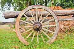 Old wooden cart wheel. Vintage wooden cart wheel on the grass Stock Photography