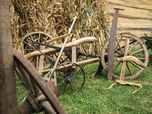 Old wooden cart-wheels on green grass. Stock Photography