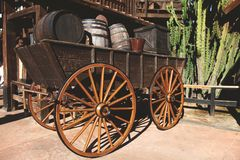 Old wooden cart with wine barrels.Wild West. Retro photo with historical transport royalty free stock images