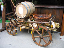 Old wooden cart with wooden barrel and grapes Royalty Free Stock Photography