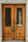 Old wooden carved door with massive bronze handles.  royalty free stock photography
