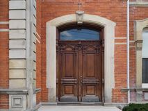 Old wooden carved double front door. Of a large house royalty free stock photo