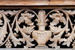 Old wooden carving with bowl and flowers Stock Photography