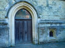 Old Wooden Cathedral Arch Door. An arched doorway at the Chichester Cathedral in Chichester, England, UK stock photos