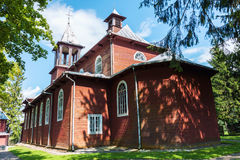 Old wooden catholic church. In Medininkai village, Lithuania Stock Photos