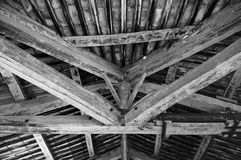Old wooden ceiling with Beams. Ceiling of an old roof of beams and old roofing tiles Stock Images