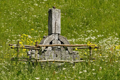An old wooden Celtic cross in a green meadow Stock Image