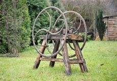 Old wooden chaff cutter. Standing on grass Royalty Free Stock Photo